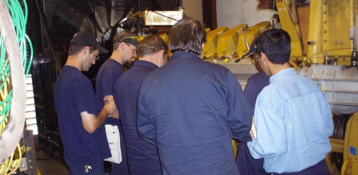 Employees participating in a workplace safety course